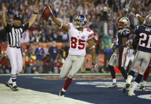 David Tyree #85 of the New York Giants celebrates his five-yard touchdown reception in the fourth quarter against the New England Patriots during Super Bowl XLII on February 3, 2008 at the University of Phoenix Stadium in Glendale, Arizona. (Photo by Donald Miralle/Getty Images)