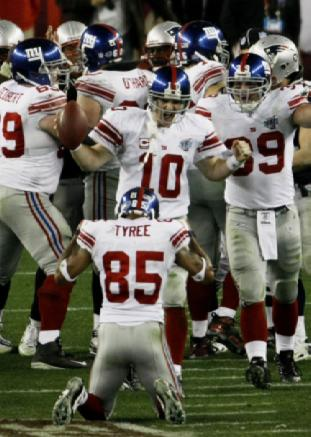 Super Bowl XLII GLENDALE, AZ - FEBRUARY 03: Quarterback Eli Manning #10 of the New York Giants celebrates their 17-14 victory against the New England Patriots during Super Bowl XLII on February 3, 2008 at the University of Phoenix Stadium in Glendale, Arizona. (Photo by Win McNamee/Getty Images)