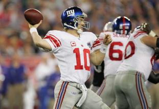 Super Bowl XLII GLENDALE, AZ - FEBRUARY 03: Quarterback Eli Manning #10 of the New York Giants passes against the New England Patriots during Super Bowl XLII on February 3, 2008 at the University of Phoenix Stadium in Glendale, Arizona. (Photo by Streeter Lecka/Getty Images)